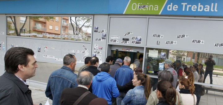 People line up at an employment office in Badalona