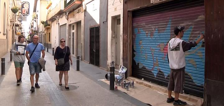 Acció de millora estètica dels locals comercials del carrer Jovara, l'any 2014